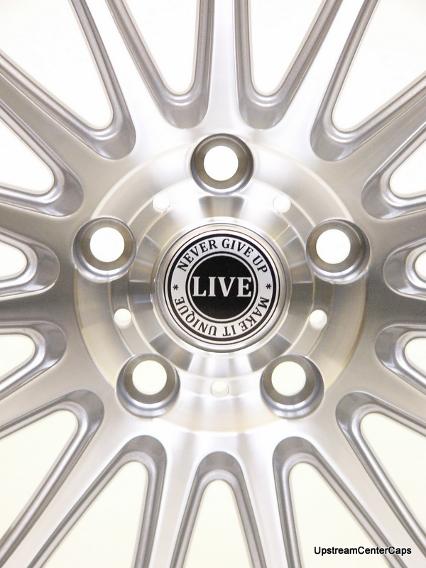 Alloy wheel centre cap live button